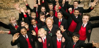 Sylvia Young, founder and principal of the Sylvia Young Theatre School, with some of her pupils