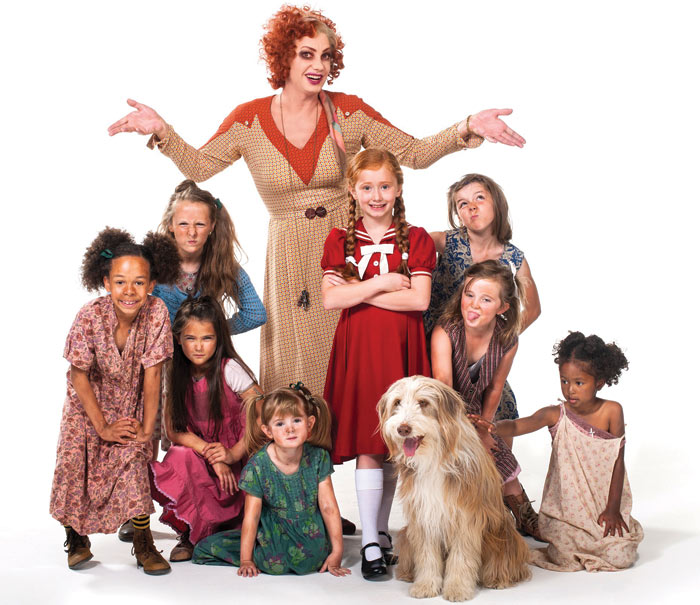 Craig Revel Horwood as Miss Hannigan with some of the cast of Annie. Photo: Hugo Glendinning