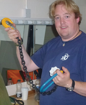 drian Cottle, ABTT silver stage technician candidate, inspects stage rigging gear
