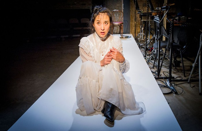Hai-Ting Chinn in The Medium at the Arcola Theatre, London. Photo: Robert Workman