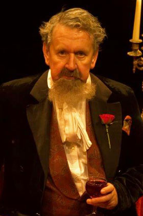 Utton as Charles Dickens