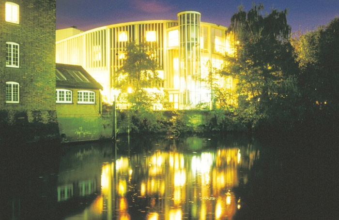 The Yvonne Arnaud at night, glittering by the River Wey