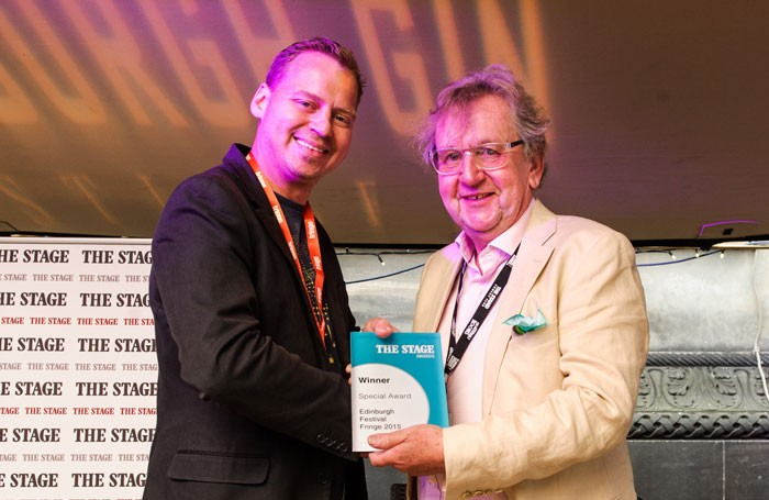 Paddy Smith, editor of The Stage, presenting Pip Utton with The Stage Special Award in Edinburgh