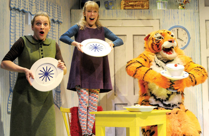Alan Atkins (Tiger) and Abbey Norman in The Tiger Who Came to Tea at the Vaudeville Theatre, London, in 2011. The show returns to the West End next month. Photo: Alastair Muir