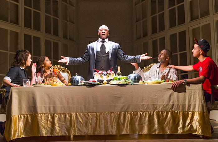 Lucian Msamati (centre), in A Wolf In Snakeskin Shoes at the Tricycle Theatre. Photo: Tristram Kenton