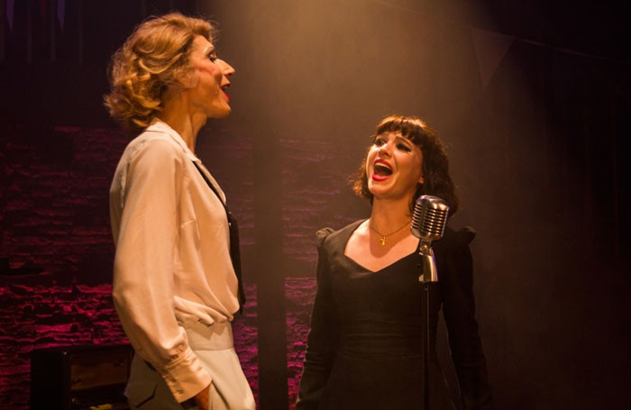 Valerie Cutko and Cameron Leigh in Piaf at Charing Cross Theatre, London. Photo: Gabriel Szalontai