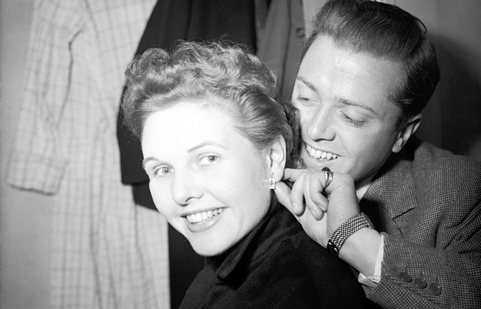Sheila Sim receives earrings from her husband Richard Attenborough as a first-night present ahead of The Mousetrap opening at The Ambassadors Theatre, London, in 1952