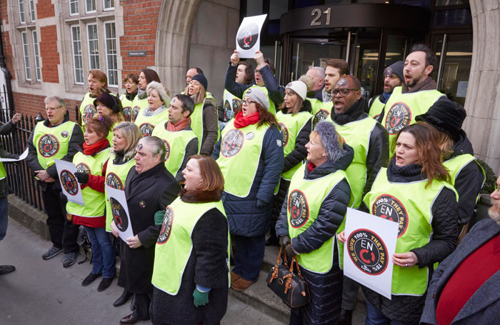 English National Opera chorus members singing outside the offices of Arts Council England. Photo: Marcus Clarkson