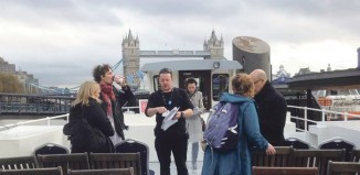 Stage manager Adam Burns (centre) on a boat on the Thames during the Almeida Theatre's 12-hour, live-streamed reading of Homer's The Odyssey last November