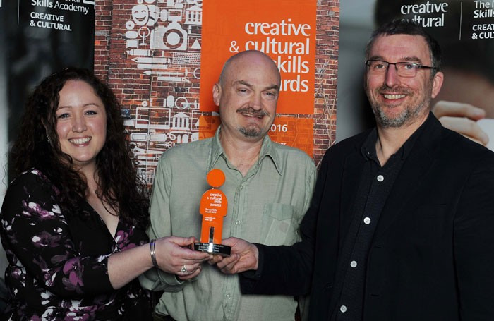 Jo Davies and Martin Hunt with Bryan Raven from White Light, who presented the award