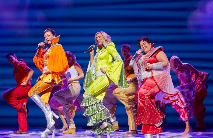 Emma Clifford, Sara Poyzer and Jacqueline Braun in Mamma-Mia! at Bristol Hippodrome. Photo: Brinkhoff Mogenburg