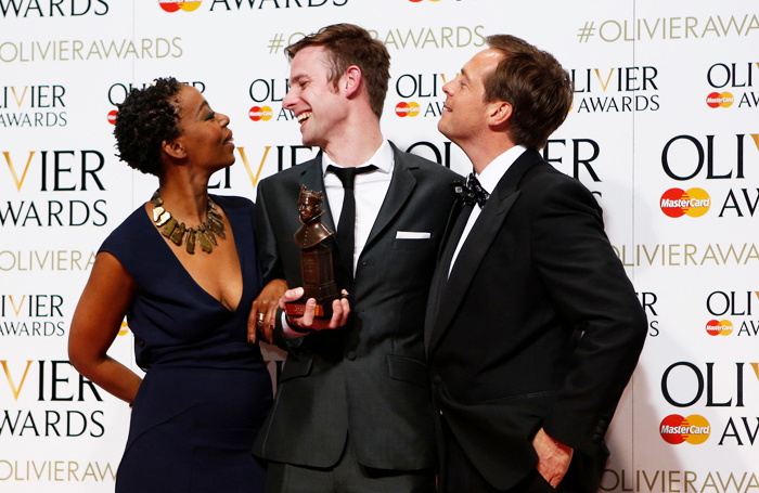 Oliver award-winner Tom Gibbons (centre) with actors Noma Dumezweni and Stephen Campbell Moore. Photo: Pamela Raith