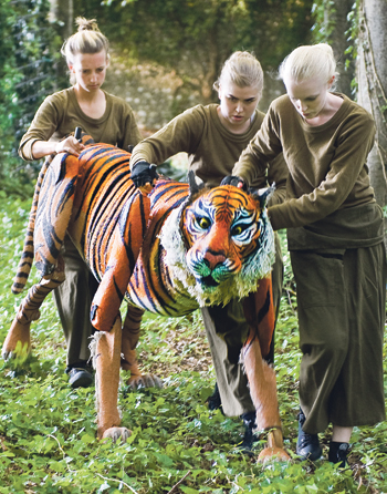 Chichester Festival Youth Theatre's production of Running Wild, with Tiger puppeteers Darcy Collins, Susie Coutts. Photo: Mike Eddowes