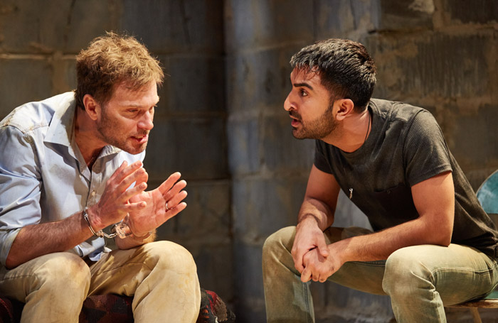 Daniel Lapaine and Nick-Parth Thakerar in The Invisible Hand at Tricycle Theatre, London. Photo: Mark Douet