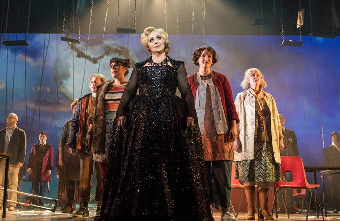 The chorus of Opera North in Into the Woods at West Yorkshire Playhouse, Leeds. Photo: Manual Harlan
