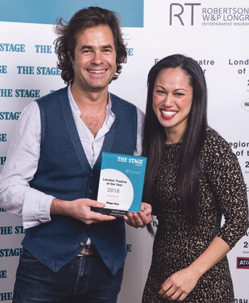 Goold receiving The Stage London Theatre of the Year Award from sponsor Suko Akulin of Haagen-Dazs in January. Photo: Alex Brenner