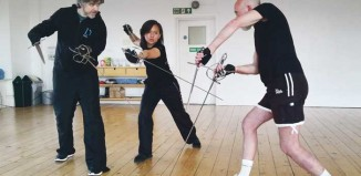 Sword play: Instructor Ronin Traynor (left) with Dita Tantang and Mark Ryder. Photo: Alexandra Kataigida