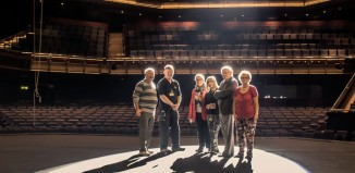 Former trustees of the Theatre Royal Applause Club test the new spotlight