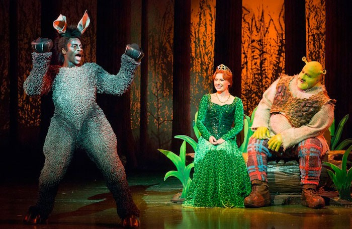 Sylvia Young graduate Idriss Kargbo with Bronte Barbe and Dean Chisnall in the UK tour of Shrek Photo: Helen Maybanks