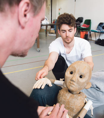 Louis Maskell in a puppetry rehearsal for The Grinning Man. Photo: Jon Craig