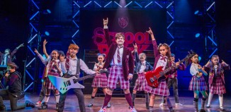 Toby Lee, David Flynn and Selma Hansen in School Of Rock at the New London Theatre. Photo: Tristram Kenton