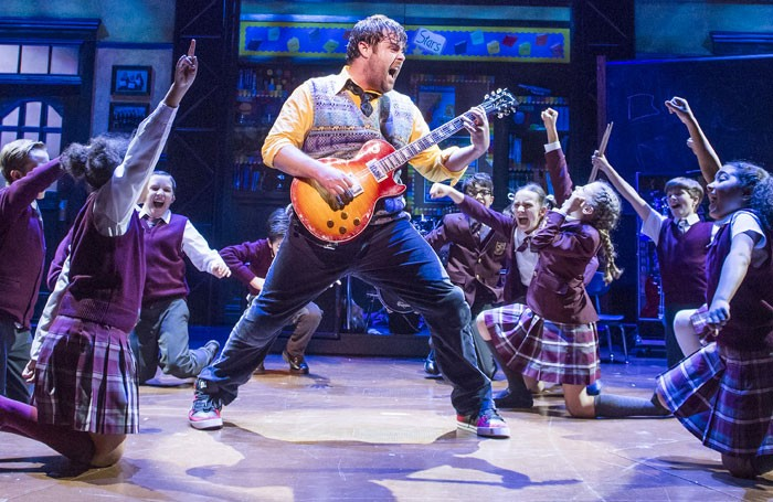 Dewey Finn (centre) and the young cast in School of Rock. Photo: Tristram Kenton