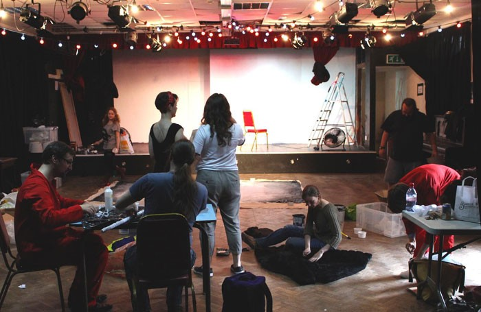 Volunteers renovating the Bristol Improv Theatre