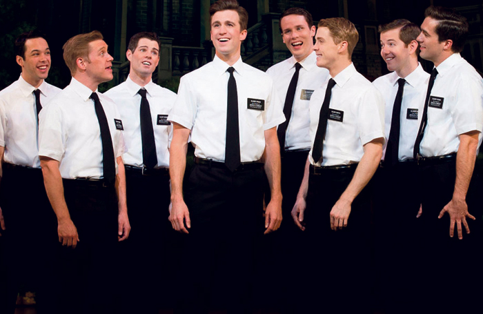 Gavin Creel (centre) and the cast of The Book of Mormon. Photo: Joan Marcus