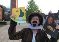 Protester Phoebe Demeger outside the Royal Shakespeare Theatre. Photo: Rikkiindymedia