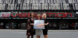 Liverpool Everyman artistic director Gemma Bodinetz (left) and executive director Deborah Aydon (right) and local MP Louise Ellman with the stamp. Photo: Glen Minikin