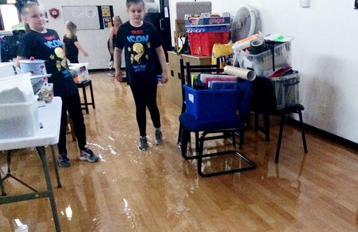 When the dance studio flooded, students took costumes upstairs to protect them from the rising water