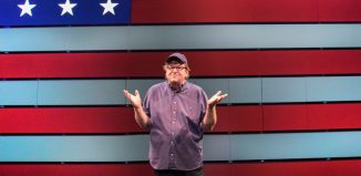 Michael Moore in The Terms of My Surrender. Photo: Joan Marcus