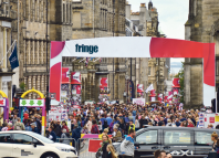 Festivalgoers throng the Royal Mile at this year's Edinburgh Fringe. Photo: Lou Armor/Shutterstock