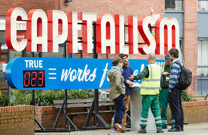 Steve Lambert's Capitalism Works For Me! (True/False). Photo: Oliver Rudkin