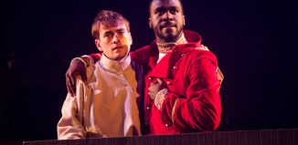 Tom England and Thierry Mabonga in Brothers Karamazov at Tron Theatre, Glasgow. Photo: John Johnston