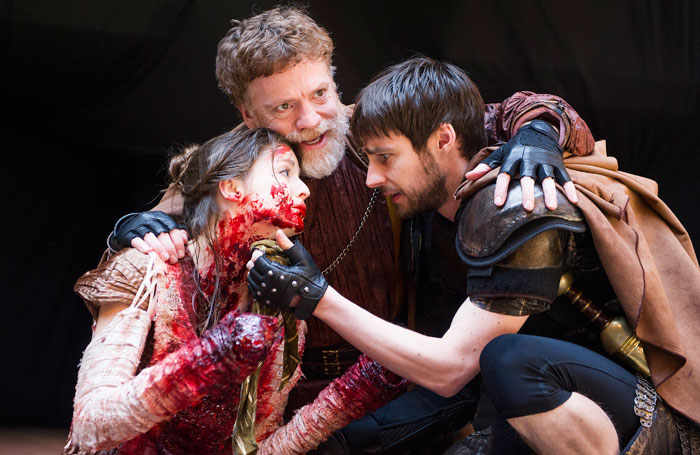 Flora Spencer-Longhurst, William Houston and Dyfan Dwyfor in Titus Andronicus at Shakespeare's Globe. Photo: Tristram Kenton