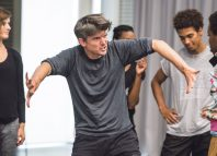 Ben Duke collaborates with dancers during rehearsals for Goat at the Rambert Dance centre on London's South Bank. Photo: Stephen Wright