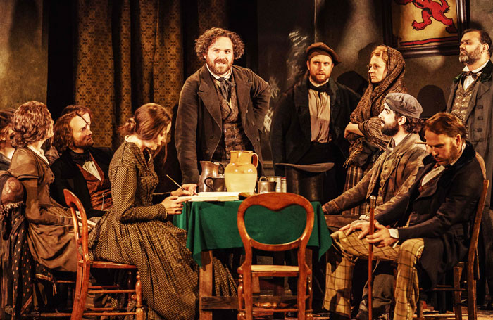 Rory Kinnear (centre) in Young Marx. Photo: Manuel Harlan