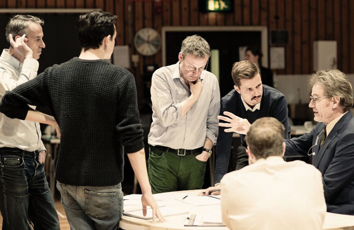 Ivo van Hove, Lee Hall, Krystian Lada and Bryan Cranston in rehearsals for Network at the National's Lyttelton Theatre. Photo: Jan Versweyveld