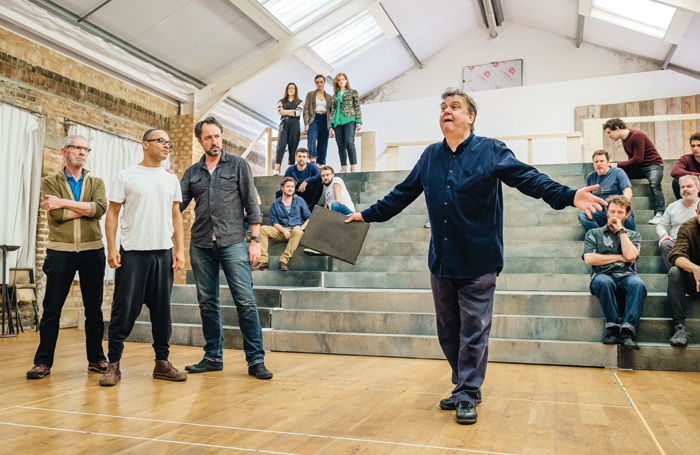 Richard McCabe (centre) leads the cast of Imperium: The Cicero Plays in rehearsal. Photo: Ikin Yum