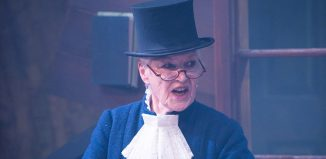 Ann Louise Ross as Scrooge in A Christmas Carol at Dundee Rep. Photo: Tommy Ga-Ken Wan