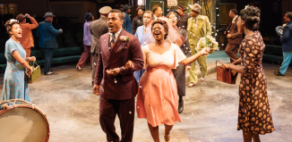Ray Fearon Lucy Vandi (centre) in Guys and Dolls at the Royal Exchange, Manchester. Photo: Manuel Harlan