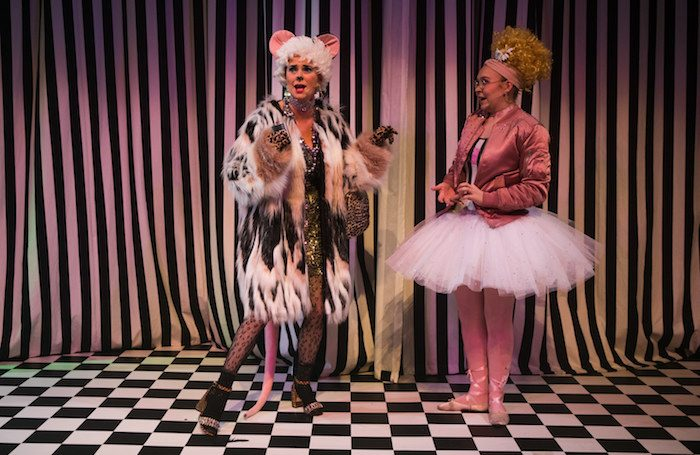 Jo Freer as Dora and Daisy Ann Fletcher as Alice, Alice in Weegieland at Tron Theatre. Photo: John Johnston
