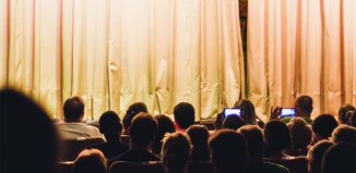 Audience behaviour: Audiences are increasingly using mobile phones once the curtain is up. Photo: Shutterstock