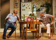 Oliver Alvin-Wilson as Robert and Ricky Fearon as Uncle Vince in Nine Night at the National Theatre. Photo: Helen Murray