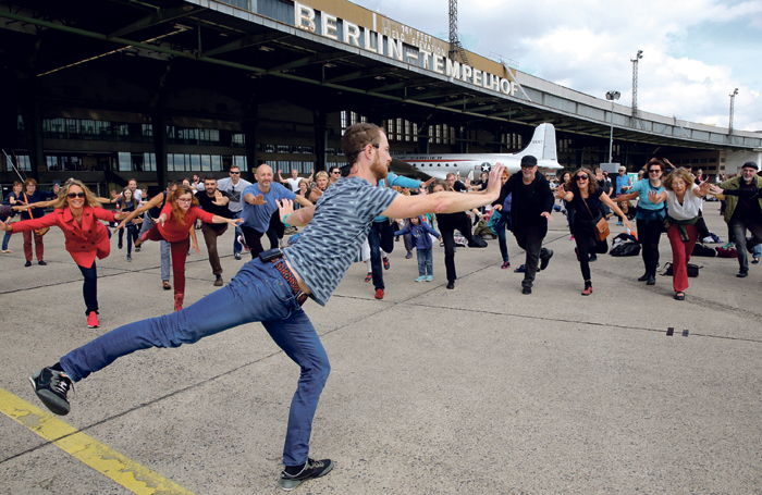 Chris Dercon's season opened with an event at Tempelhof that included dance performance and a public dance warm-up with choreographer Boris Charmatz