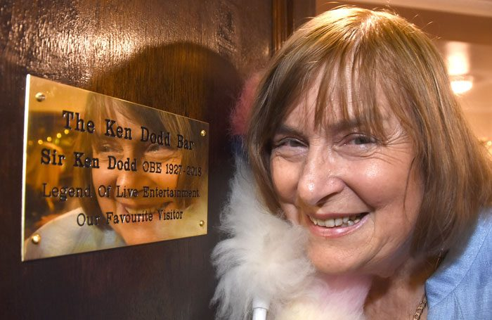 Anne Dodd with the memorial plaque at the Grand Opera House in York. Photo: David Harrison/Grand Opera House York