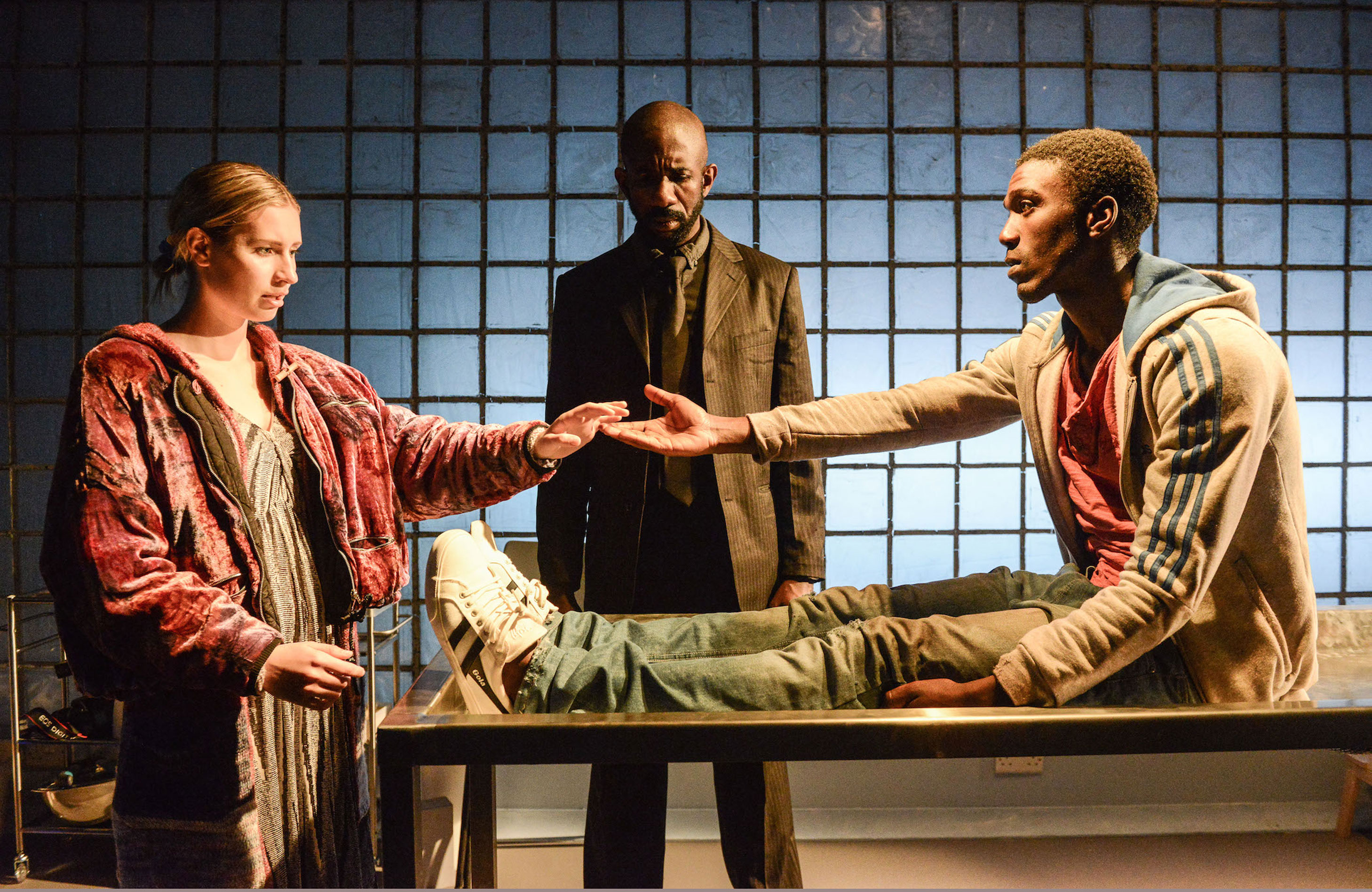 Callie Cooke, Rhashan Stone and Benjamin Cawley in The Strange Death of John Doe at Hampstead Theatre, London. Photo: Robert Day