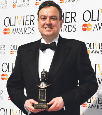 McCabe with his Olivier award for best supporting actor, for The Audience, in 2013. Photo: Sarah Jeynes