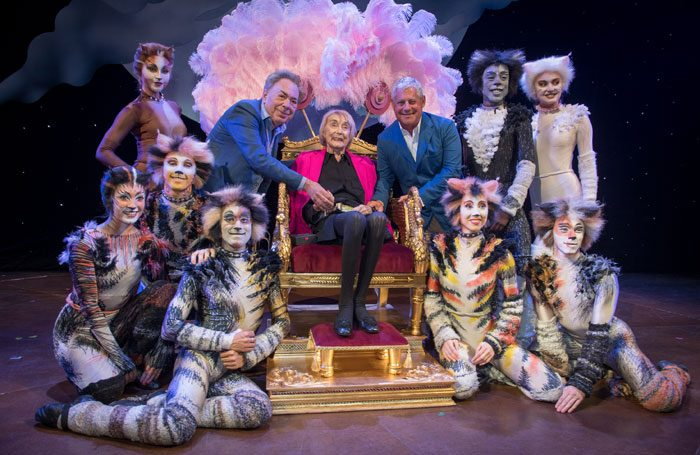 Gillian Lynne, seated, with Andrew Lloyd Webber and Cameron Mackintosh, and cast members of Cats. Photo: Craig Sugden